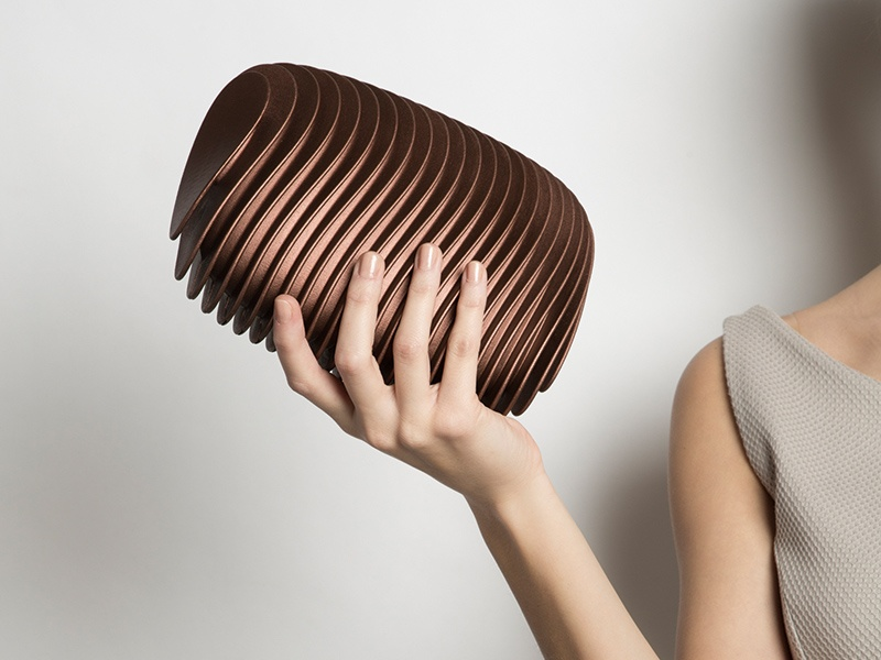 Designed by Odo Fioravanti for Maison 203, the visually intriguing Bern clutch reflects the uniqueness of Switzerland's capital. The pulsating pattern creates an optical effect that makes it appear to change shape depending on the angle.
