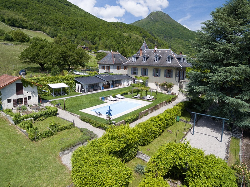 With unique and unspoiled panoramic views of the mountains, this 15th-century house in Cruet has six bedrooms and three bathrooms. Photograph: Agence Clerc