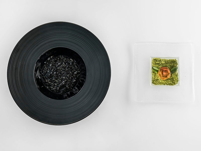 """Part of the """"Bekarki"""" tasting menu, a deliciously complex squid-ink risotto with a butter flower."""
