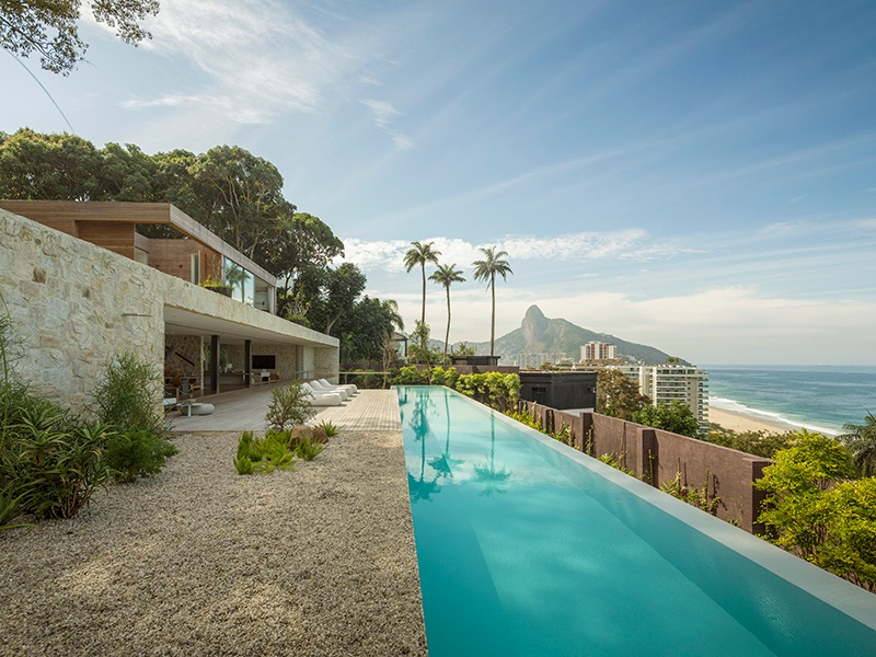 At ALHouse, on a steep site in the hills near Rio de Janeiro, Studio Arthur Casas captured panoramic views for its client by elevating the living areas. Photograph: Fernando Guerra
