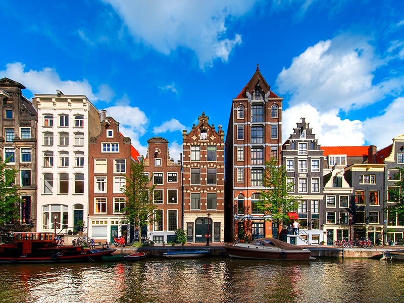 Visitors to Amsterdam can join the locals in traversing a variety of scenic bicycle routes through the Dutch capital. Photograph: Getty Images