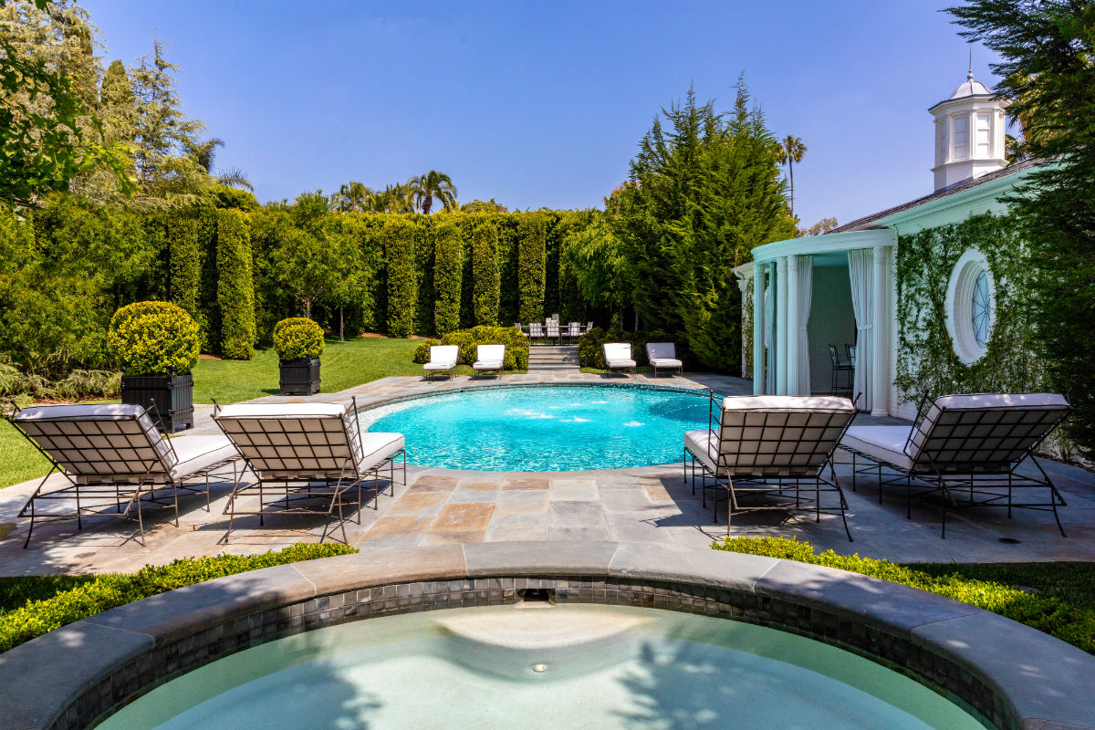 The very private back yard features a pool, spa, and cabana.