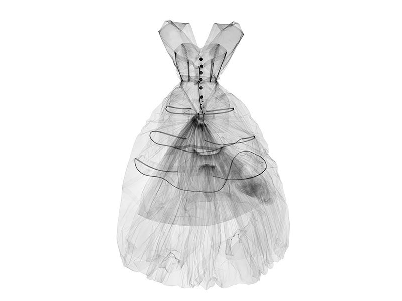 A 2016 X-ray photograph of a silk taffeta evening dress created by Cristóbal Balenciaga in 1955. <i>Balenciaga: Shaping Fashion</i>, sponsored by American Express, is at the V&amp;A until February 18, 2018. Photograph: ©Nick Veasey