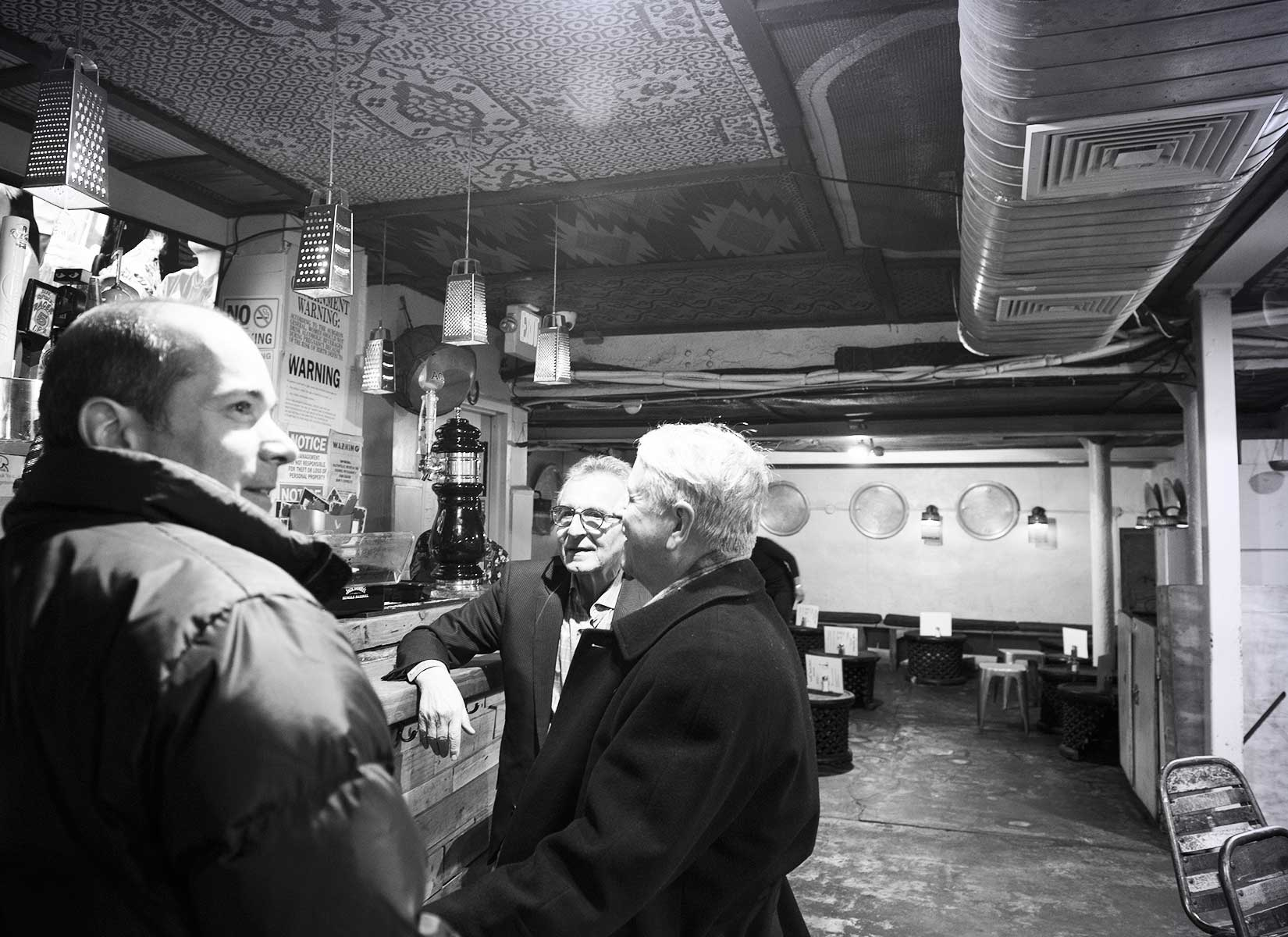 Dan Conn, Edward Joseph, and Grant Weaver (pictured from left to right) take in the sights and sounds of one of Harlem's legendary jazz venues.