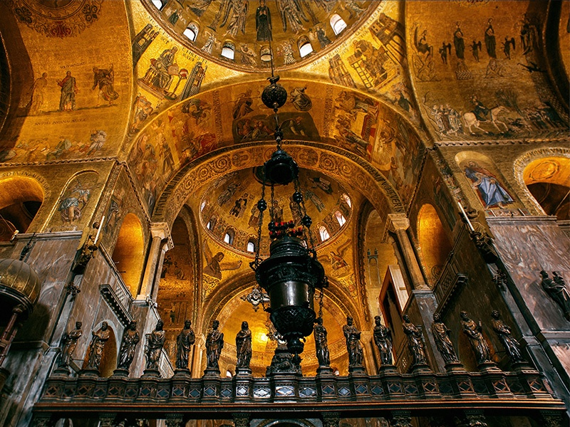 More than 86,000 square feet of mosaics cover the walls, vaults, and cupolas inside the Basilica di San Marco. Photograph: Getty Images