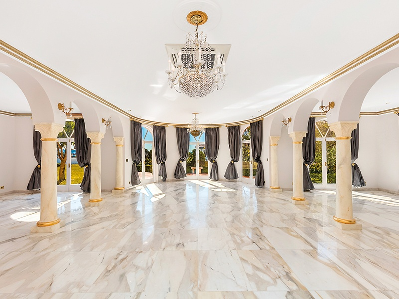 A grand ballroom on the lower level—complete with Italian chandeliers and marble floors—is perfect for entertaining. Or take it outside to the terraces overlooking the property's gardens and patios. Photograph: Craig Bryant