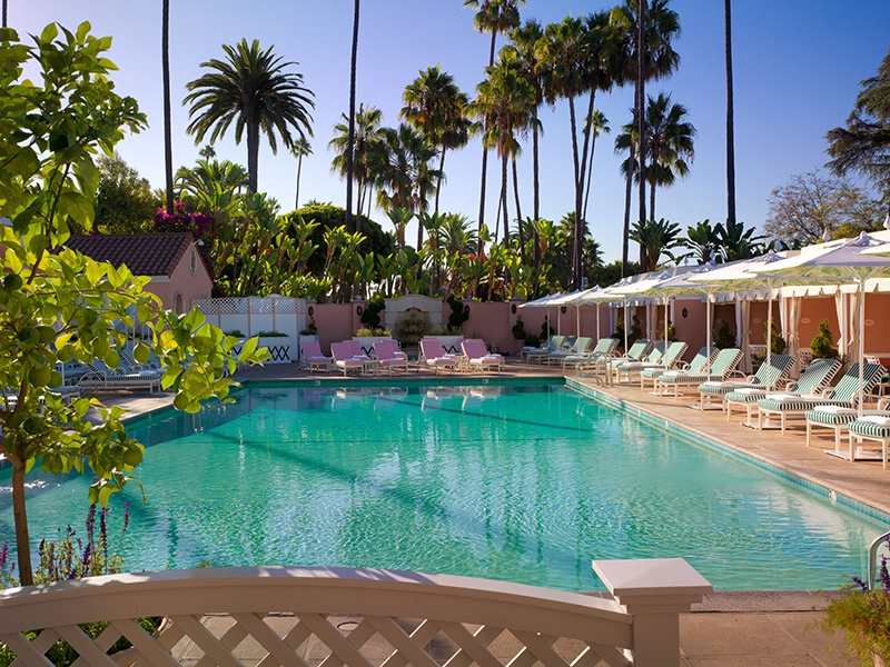 The exterior of the iconic Beverly Hills Hotel was first painted its distinctive pink in 1948 to complement the color of the Los Angeles sunset. In 1949 the hotel gained its pink-and-green motif—still present today.