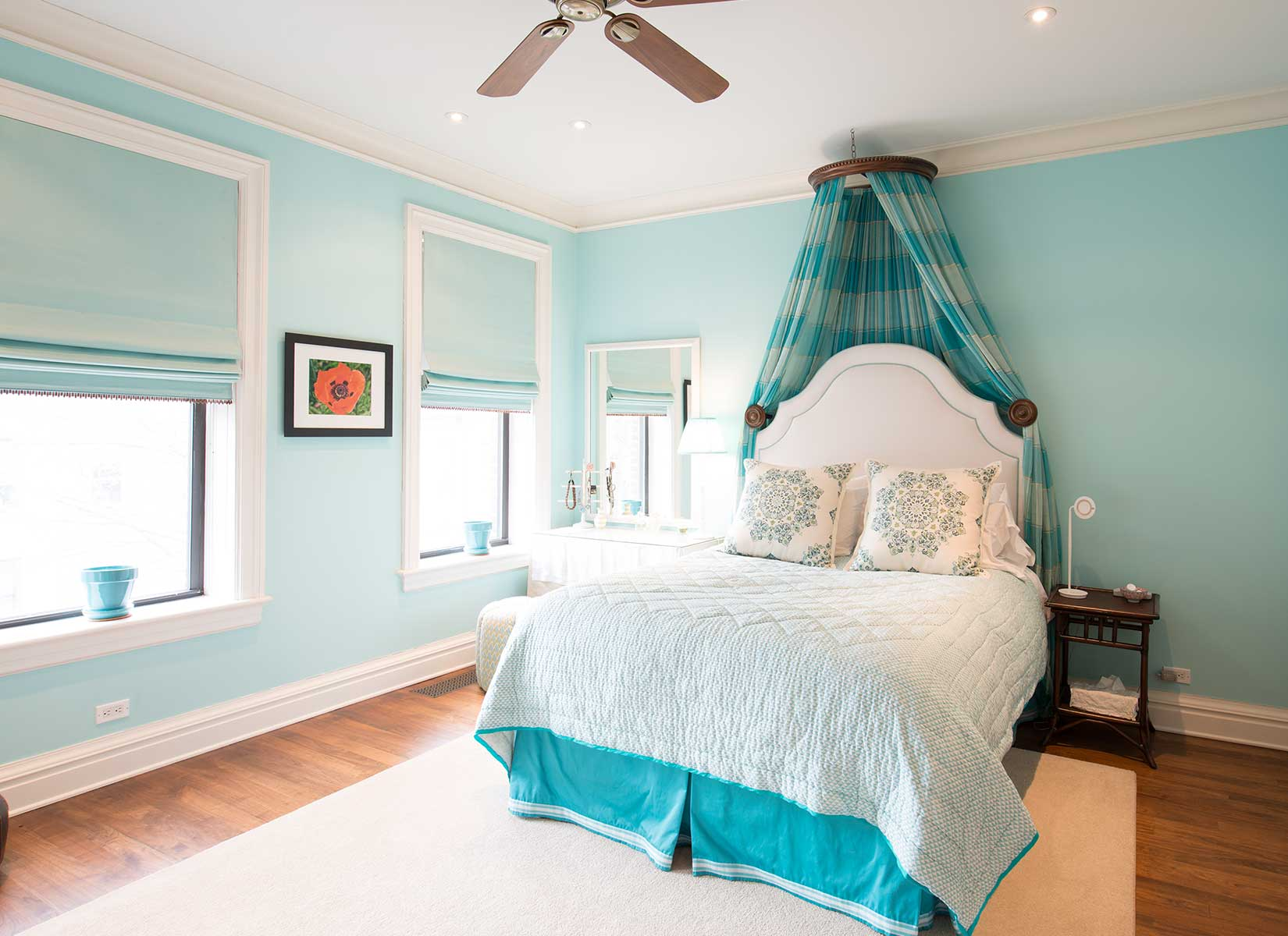 The spacious front bedroom has a full en suite bathroom with a soaking tub and marble surround.