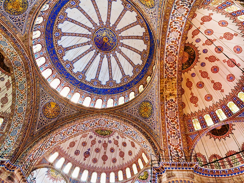 Around 20,000 Iznik tiles in a rainbow of colors make up the domed ceiling inside Istanbul's Blue Mosque. Photograph: Getty Images