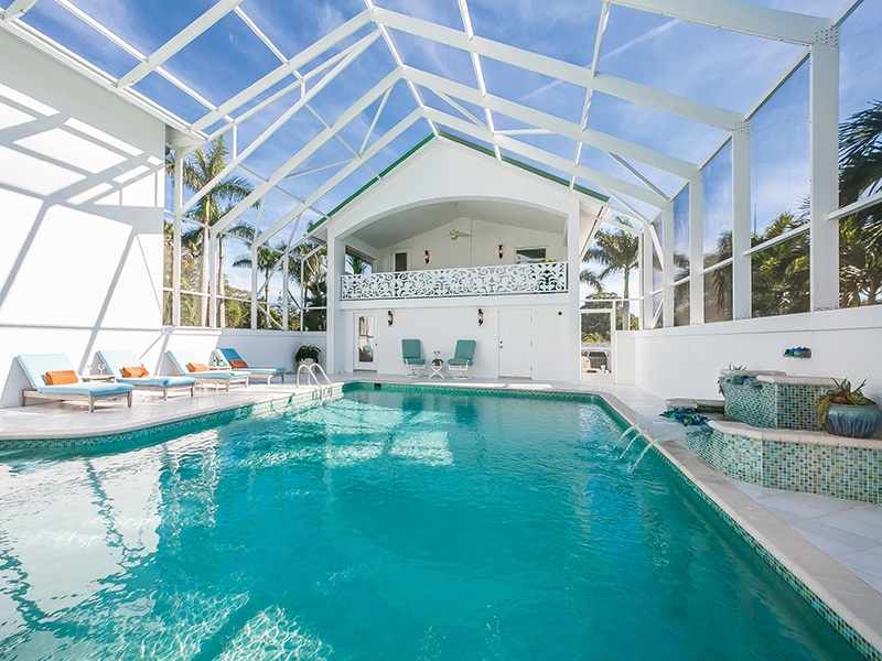 This home in Bradenton, Florida, may, at first glance, have neutral interiors, but bold splashes of color throughout remind residents of its enviable shoreline setting. Pops of blue, turquoise, and green adorn tiles, fireplaces, furniture, fittings, and even the roof. On the market with Michael Saunders & Company, Christie's International Real Estate's exclusive affiliate in the region.