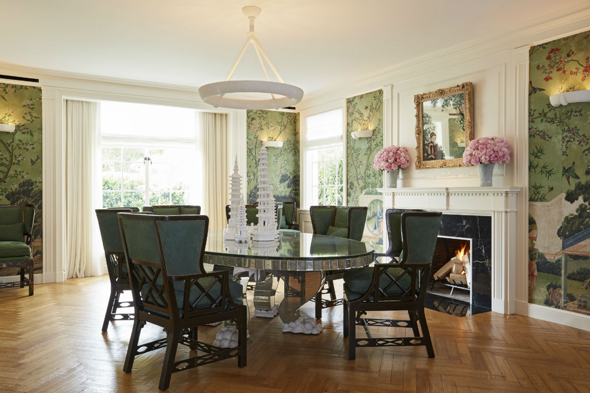 The breakfast room is elegantly decorated with antique wallpaper and is ideal for informal meals.