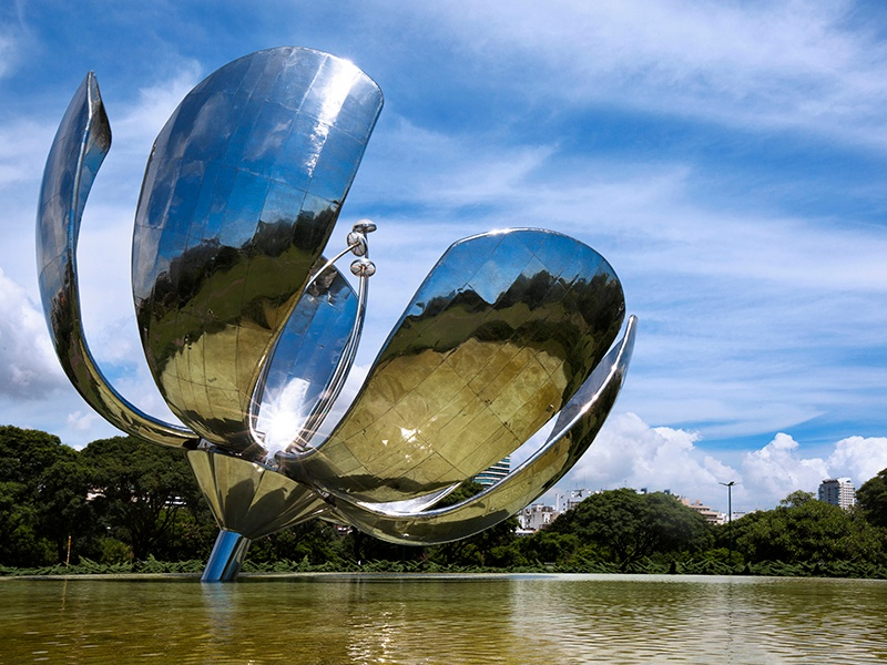 Designed and gifted to the city by Argentine architect Eduardo Catalano, the steel and aluminum Floralis Genérica is 105 feet wide when in full bloom. Banner image: The green dome of the neo-classical Palacio del Congreso towers above the Buenos Aires skyline. Photographs: Getty Images