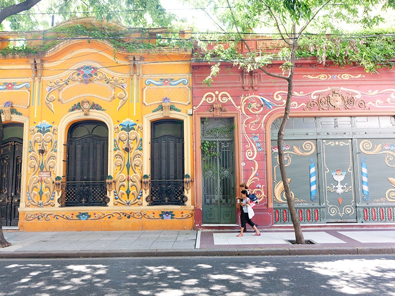 These colorful painted houses in the Abasto neighborhood are not far from a monument and museum dedicated to Carlos Gardel, a renowned tango singer. Photograph: Getty Images