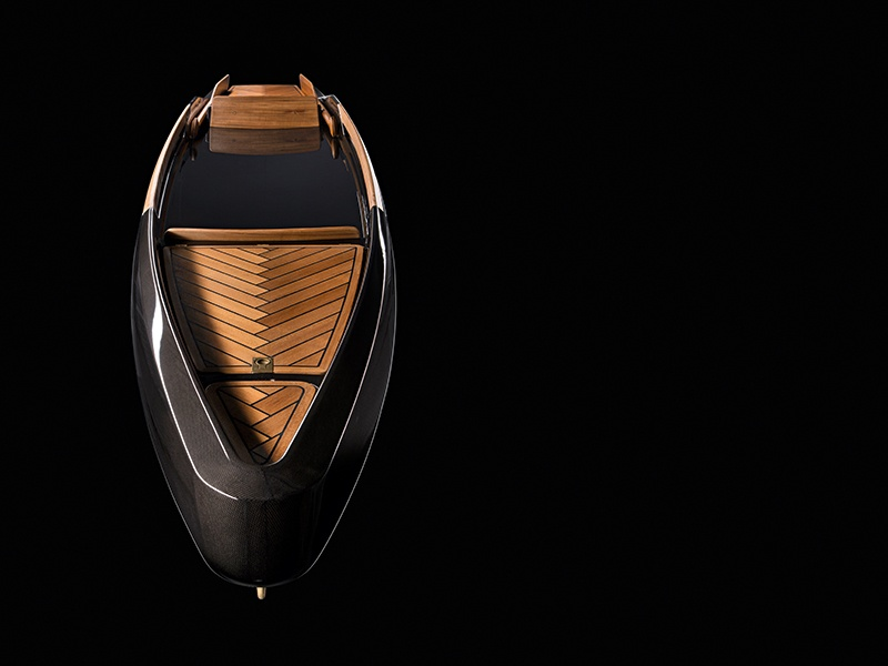 The oars of the Monocoque Paddle Canoe tuck away on the side as a homage to the fins on a Cadillac.