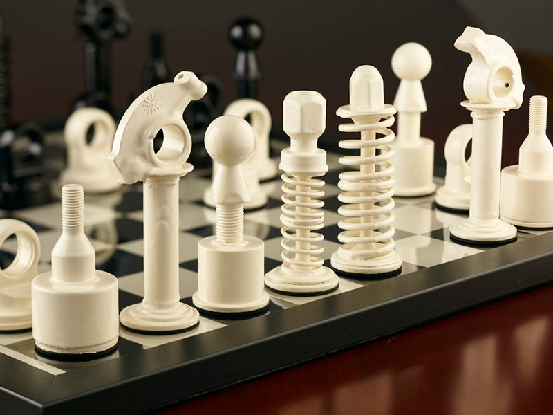 Crafted using recycled parts from Aston Martin, Range Rover, and Lotus vehicles, this handmade chess set makes an impressive statement.