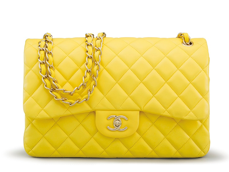 <strong>YELLOW LAMBSKIN LEATHER JUMBO DOUBLE FLAP BAG</strong><br>CHANEL, 2012<br>Auction estimate: $3,000-$4,000<br>December Holiday Auction 2016
