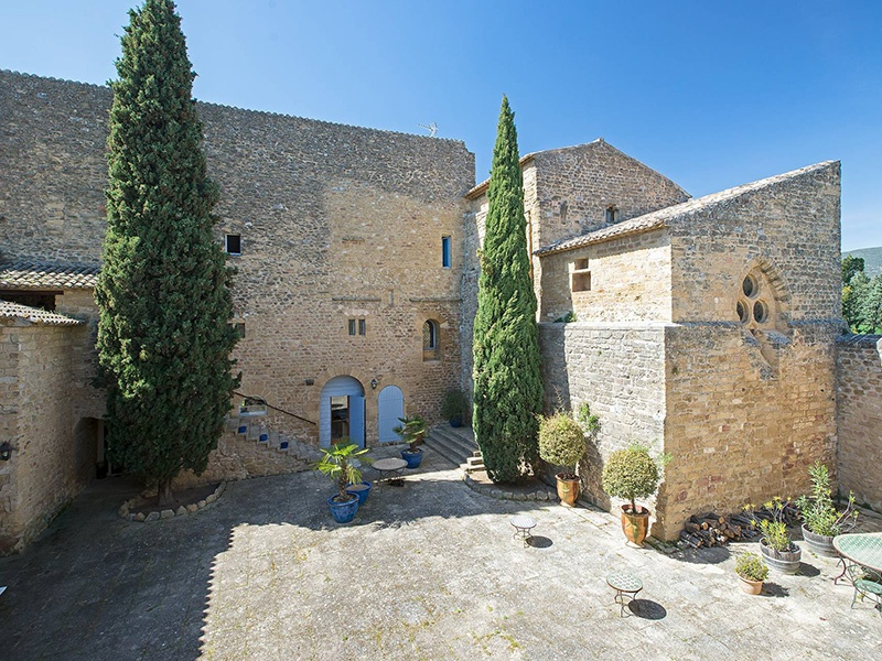 The interior courtyard of this Puyvert property is ideal for large gatherings and celebrations. Photograph: Michaël Zingraf Real Estate