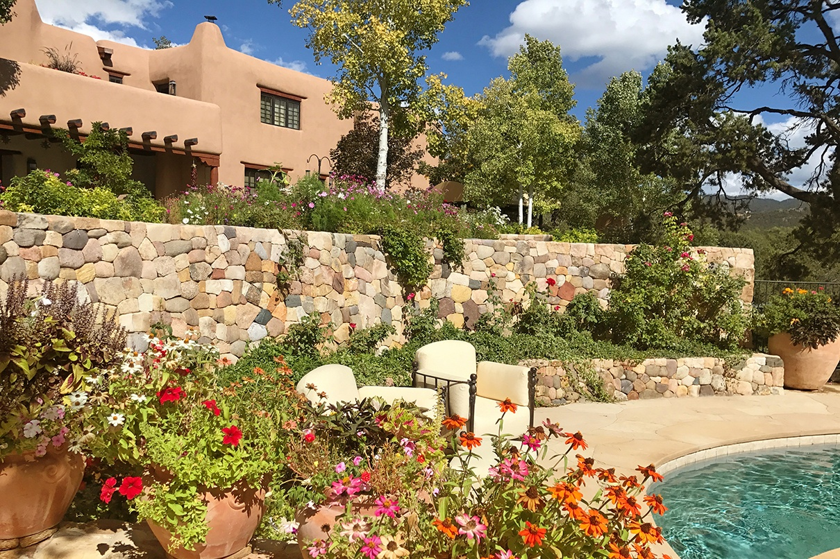 The Opera House, a magnificent Pueblo Revival residence on 11 high-desert acres is one of the finest homes in Santa Fe, New Mexico.