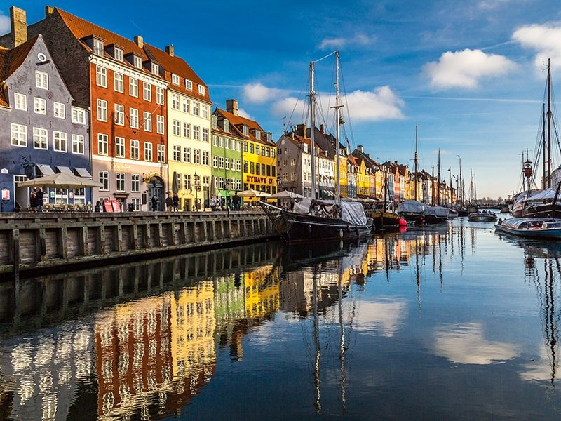 Some of the colorful houses along Nyhavn harbor in Copenhagen are more than 350 years old. The city has a website, Go Green Copenhagen, designed to help visitors discover the city's eco-friendly businesses. Photograph: Getty Images