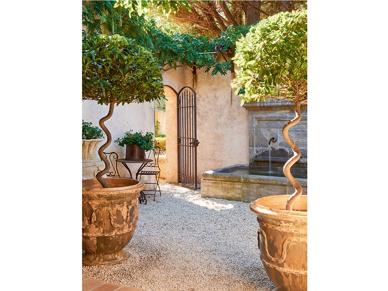 An elegant courtyard, complete with a stone fountain, is tucked away amid the villa's grounds. Photograph: Frederic Vasseur