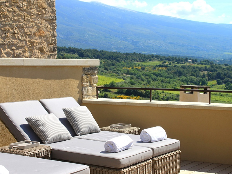 The vineyards, fields, and mountains of Provence can be seen from Hotel Crillon le Brave.