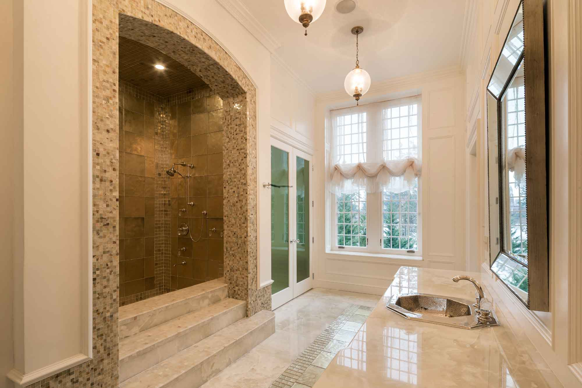Darlington's his-and-her master bathroom is finished in marble and equipped with the finest spa-inspired amenities. The 50,000-square-foot, 21-bedroom mansion boasts an additional 28 bathrooms (all beautifully rebuilt during the home's remarkable seven-year restoration).