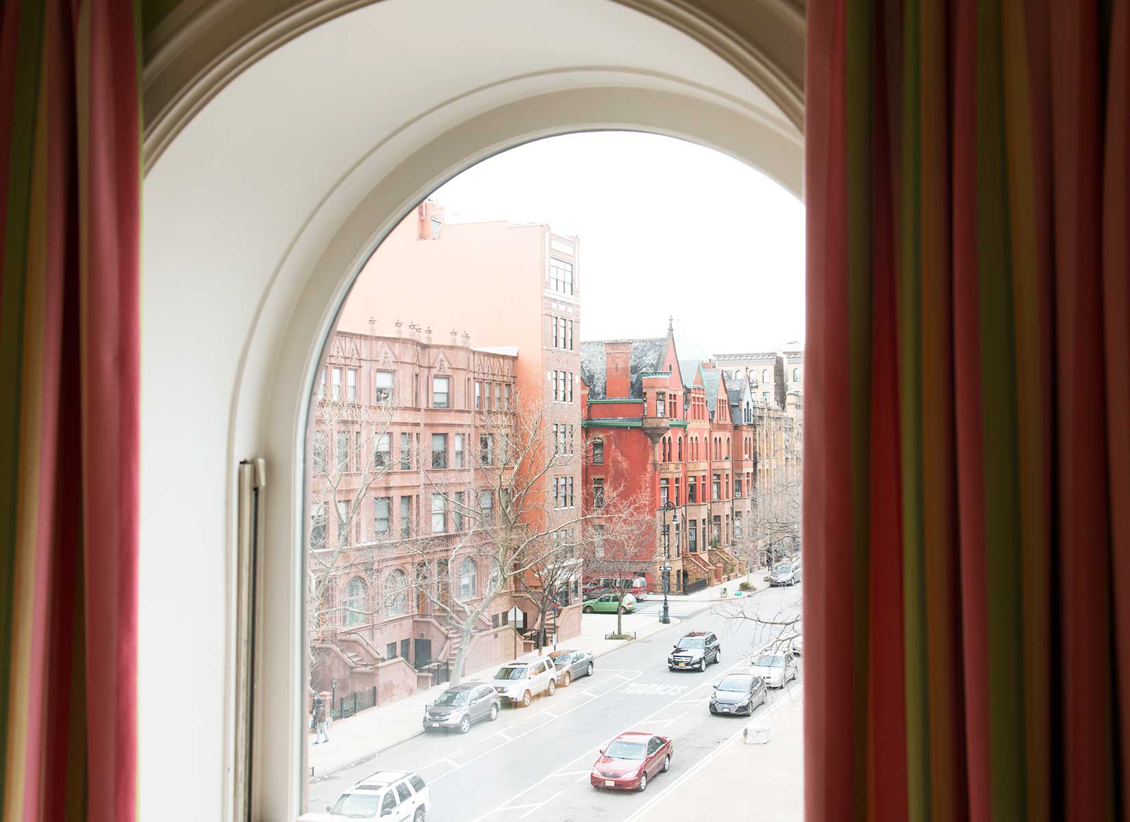 Across from Marcus Garvey Park and ideally situated in the Mount Morris Park Historic District, the residence is convenient to transit and Harlem's famed jazz and dining destinations, including Minton's Playhouse and Michelin-starred Sushi Inoue.