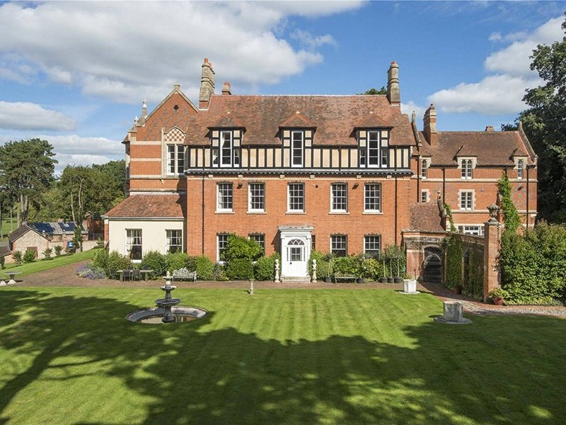 Fully modernized, The College in Devon has maintained its character features, such as decorative tiles; timber floors; wooden panelling; stone, wooden, and marble fireplaces; and beautifully ornate plaster work.