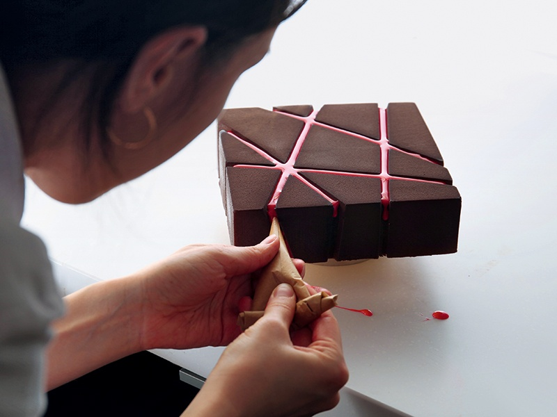 """Using the """"Chocolate Block"""" mold, this Valrhona chocolate cake has a crunchy layer topped with sponge cake, crémeux, and two types of chocolate mousse. Photograph: Dinara Kasko"""