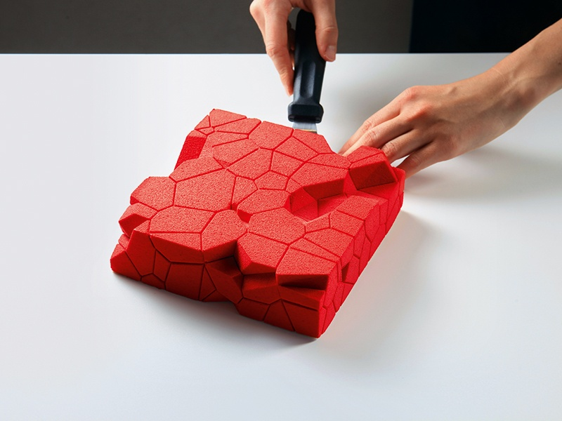 """Dinara Kasko's """"Cluster"""" mold was created using a Voronoi diagram, which is typically used in mathematics. The chocolate sponge cake layers chocolate mousse, confit raspberry, confit blackcurrant, and shortcrust dough, and is covered with a chocolate spray. Photograph: Dinara Kasko"""