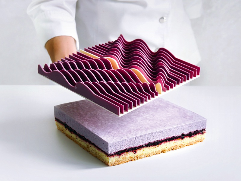 """These """"Kinetic"""" tarts were made in collaboration with José Margulis, an artist from Miami who works with geometric abstractionism and kinetic art. Inside the tart? Streusel, almond sponge cake, confit blackberry and blueberry, mousse with blackberry, and mascarpone. Photograph: Dinara Kasko"""