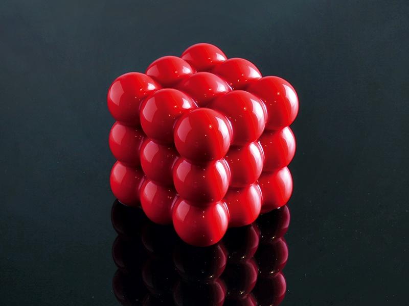 "The ""3x3x3"" mold creates a geometric dessert—hard to believe it contains pistachio sponge cake, raspberry mousse, raspberry cream, and confit raspberry. Photograph: Dinara Kasko"