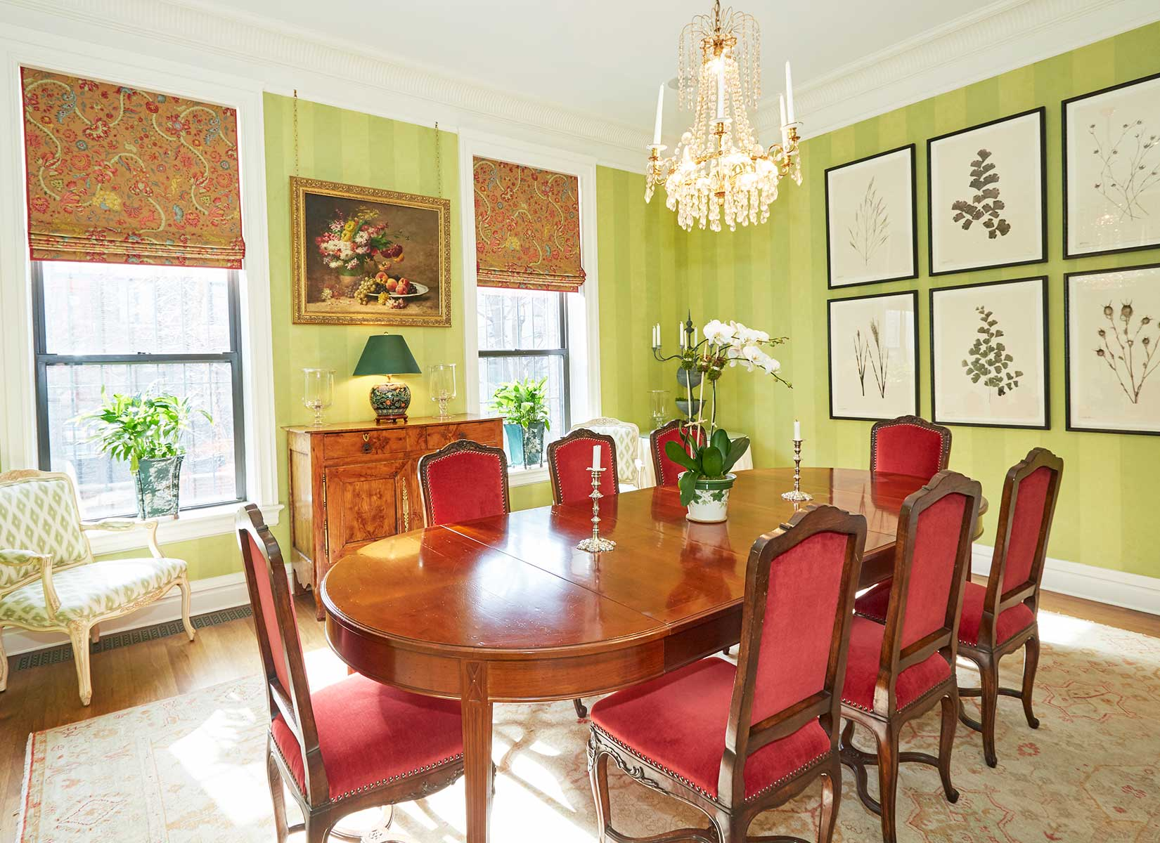 The formal dining room is accented by elaborate moldings and two large windows facing south.