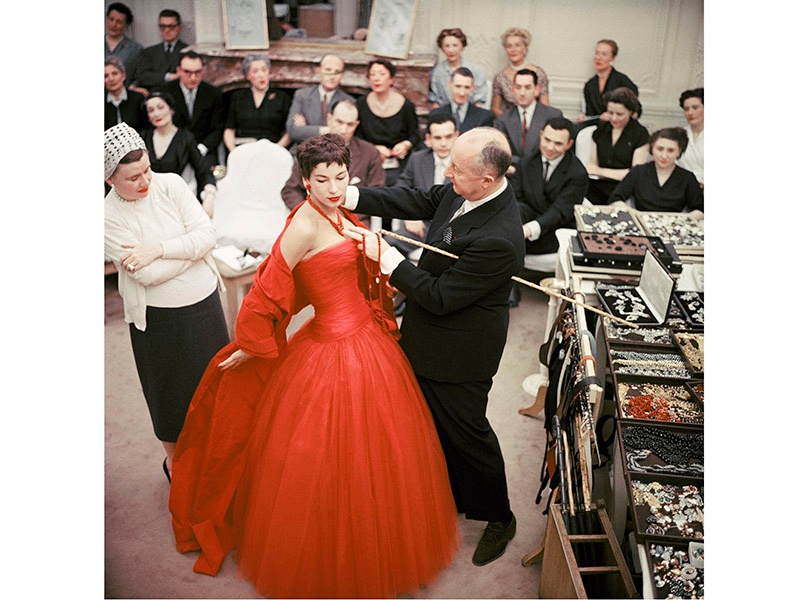 Christian Dior adjusts the Zaire dress on model Victoire during rehearsals for the 1954 autumn/winter haute couture show. Photograph: ©Mark Shaw/mptvimages.com