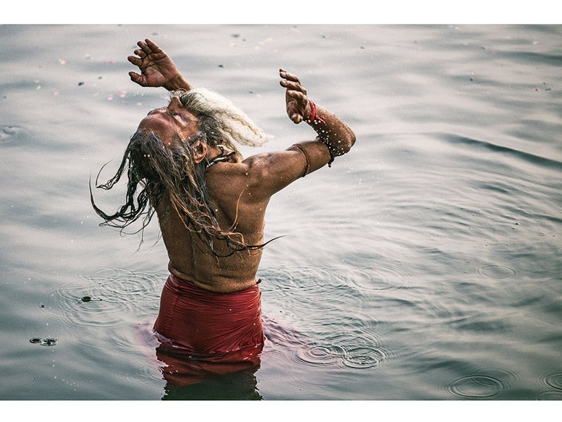 A man takes his daily dip in the River Ganges at dawn in Varanasi, Uttar Pradesh, India. Drew Hopper spent a week in Varanasi exploring the banks of the holy river, documenting the daily life of the people who worship the Ganges. Photograph: ©Drew Hopper Photography