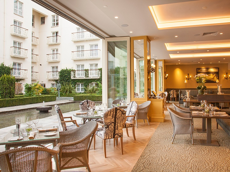 The recently opened Garden Room at The Merrion in Dublin has glass doors that open out onto a courtyard filled with sculpture and decorative fountains.