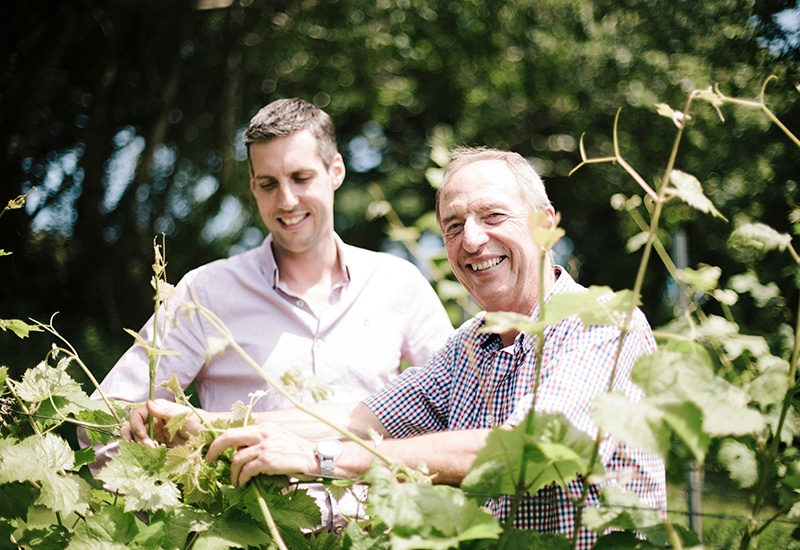 Camel Valley founder Bob Lindo and his son and second-generation winemaker Sam among the Cornish vines that produce the winery's award-winning bottles.
