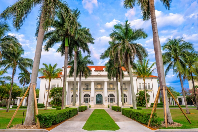 """Built in 1902, Flagler's Gilded Age estate, Whitehall, (now the Henry Morrison Flagler Museum) was proclaimed by the <em>New York Herald</em> as &quot;more wonderful than any palace in Europe, grander and more magnificent than any other private dwelling in the world."""""""