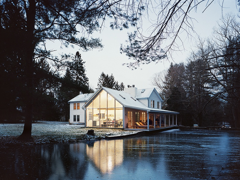 Tom Givone spent four years on the Floating Farmhouse. The 1820s Catskills manor features a veranda that projects out across the surface of a neighboring creek, hence the name. Photograph: Mark Mahaney