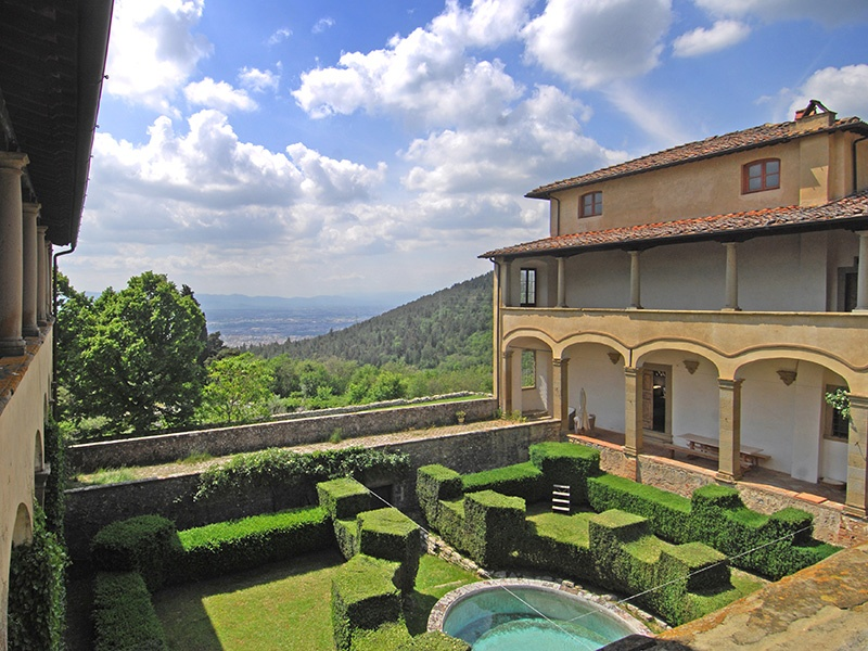 The property offers views of olive groves and woodland, and the hills near Florence.