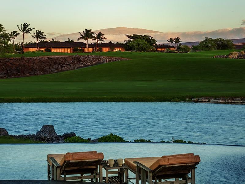 The property offers panoramic views, with Mauna Kea, Hualalai, and Kohala Mountain serving as a backdrop. Photograph: Hawaii Life Real Estate Brokers