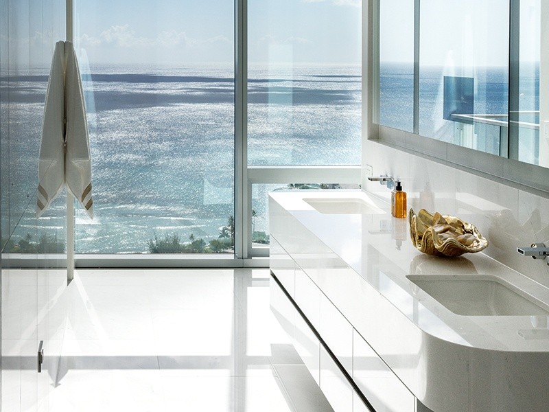 Natural materials such as metal, stone, and marble are incorporated into the apartment's interior design for their reflective properties—nodding to the glistening ocean beyond. Photograph: Paul Raeside