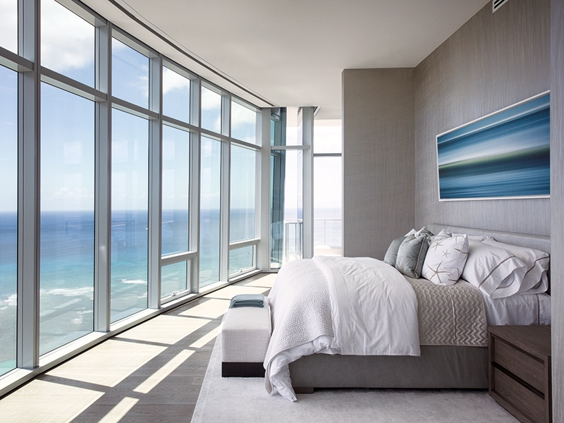 """When creating the interior, designer Tony Ingrao took """"the silvers and gray from the water and sky and infused warm wood elements into the furnishings, for a home that is at once unique yet totally Hawaii."""" Photograph: Paul Raeside"""
