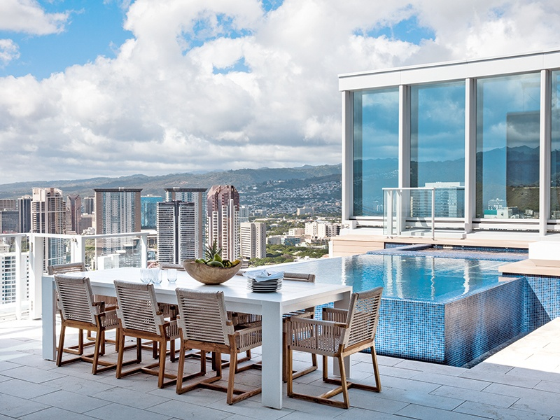 Looking out over Honolulu and towards the sea, the infinity-edge pool sits alongside a 1,357-square-foot private lanai. Photograph: Paul Raeside