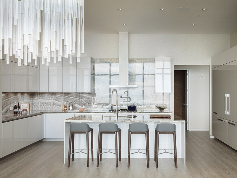 The fully equipped kitchen, with its polished quartz surfaces, is complemented by a wine store and humidor. Photograph: Paul Raeside