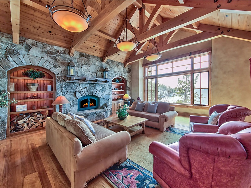 The open-plan living space of this Incline Village property features elegant wood and stone finishes. Photograph: Oliver Luxury Real Estate