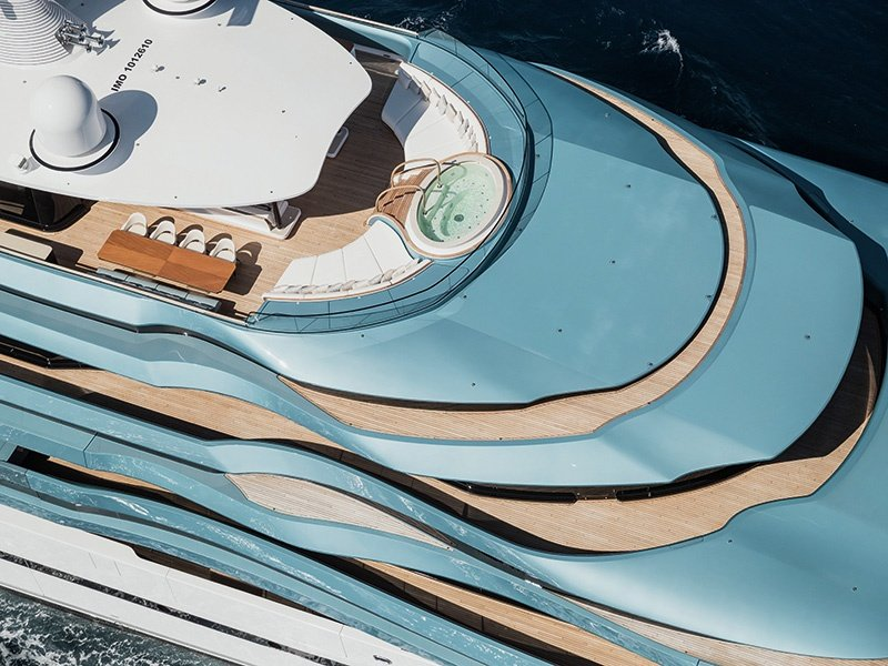 Imitation decks—smoked-glass panels running the length of the superyacht and areas of teak—mask the true height of <i>Jubilee</i>.