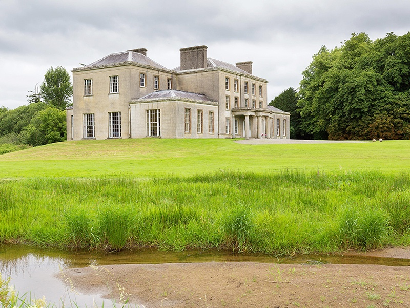 Kilfane House, an impressive country estate comprising a three-story Georgian property plus caretaker's residence and a gate lodge, offers complete privacy in an idyllic setting.