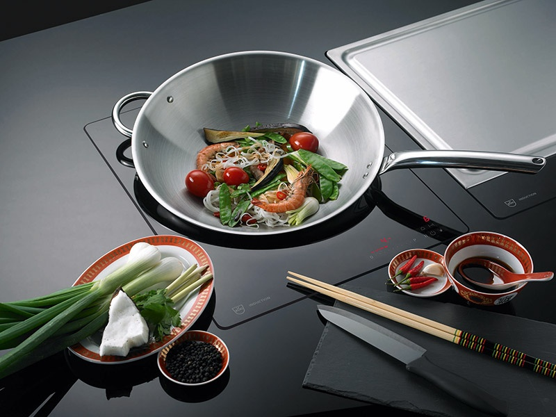 V-ZUG's range of stove tops are flush-fitted, creating a sleek look in the kitchen.
