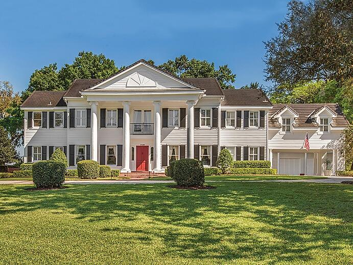The plantation-style property at 11536 Lake Butler Boulevard benefits from 500 feet of shoreline, and has five bedrooms and eight bathrooms. Photograph: Regal Real Estate Professionals